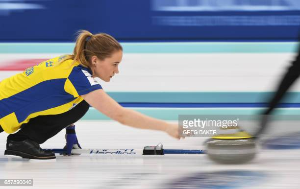 TOPSHOT Sweden's Sara McManus releases the stone during their playoff against Scotland at the Women's Curling World Championships in Beijing on March...