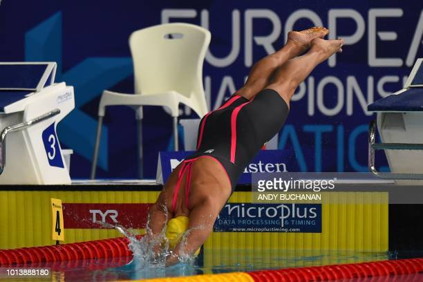 Sweden's Sarah Sjoestroem competes in the Women's 50m butterfly swimming final at the Tollcross swimming centre during the 2018 European...