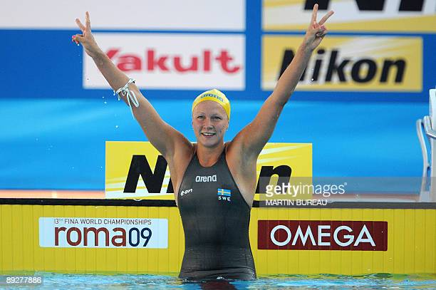 Sweden's Sarah Sjostrom celebrates after winning gold and beating a world record during the women's 100m butterfly final on July 27 2009 at the FINA...