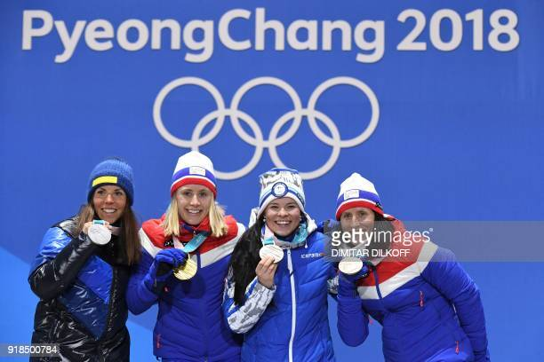 Sweden's silver medallist Charlotte Kalla Norway's gold medallist Ragnhild Haga and bronze medallists Finland's Krista Parmakoski and Norway's Marit...