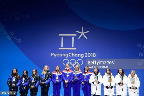 Sweden's silver medallists Anna Haag Charlotte Kalla Ebba Andersson and Stina Nilsson Norway's gold medallists Ingvild Flugstad Oestberg Astrid...