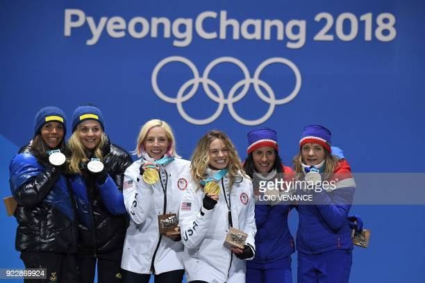 Sweden's silver medallists Charlotte Kalla and Stina Nilsson, USA's gold medallists Kikkan Randall and Jessica Diggins, and Norway's Marit Bjoergen...