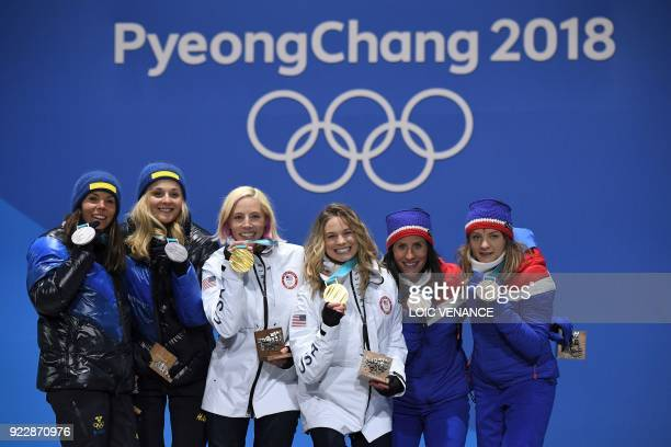 Sweden's silver medallists Charlotte Kalla and Stina Nilsson USA's gold medallists Kikkan Randall and Jessica Diggins and Norway's Marit Bjoergen and...