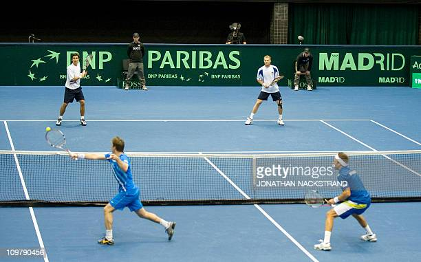Sweden's Simon Aspelin and Robert Lindstedt returns against Russia's Igor Kunitsyn and Dmitry Tursunov during their Davis Cup first round doubles...