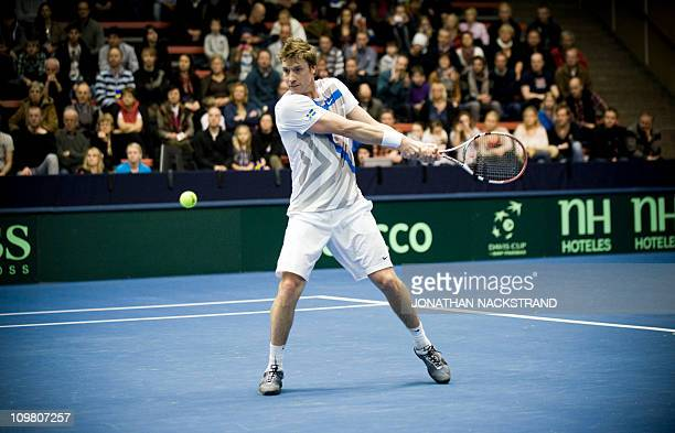 Sweden's Simon Aspelin returns the ball to Russia's Dmitry Tursunov during their Davis Cup first round singles match at the Borashallen stadium in...