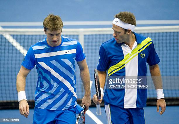Sweden's Simon Aspelin talk with Robert Lindstedt during their Davis Cup first round doubles match against Russia's Igor Kunitsyn and Dmitry Tursunov...