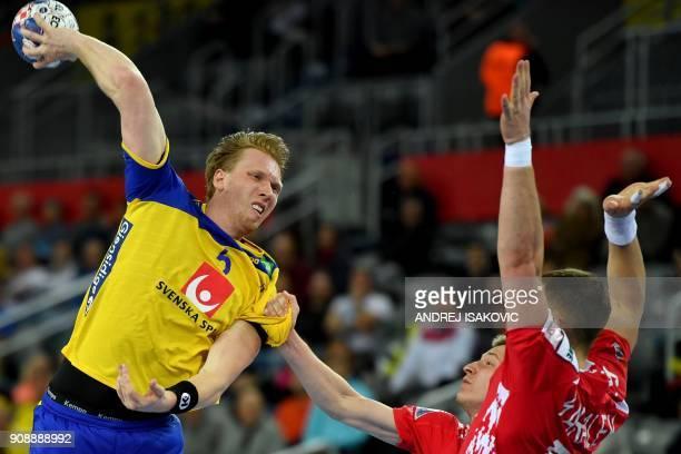 TOPSHOT Sweden's Simon Jeppson vies with Belarus' Mikalai Aliokhin and Artsem Karalek during the the Men's 2018 EHF European Handball Championship...