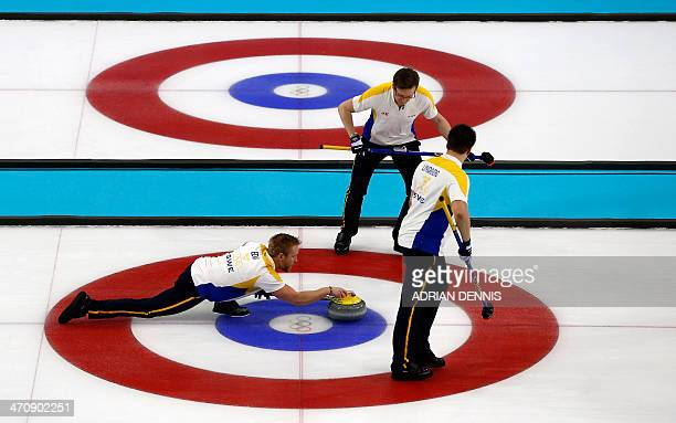Sweden's Skip Niklas Edin throws a stone during the men's Bronze medal match between Sweden and China at the Ice Cube curling centre in Sochi on...