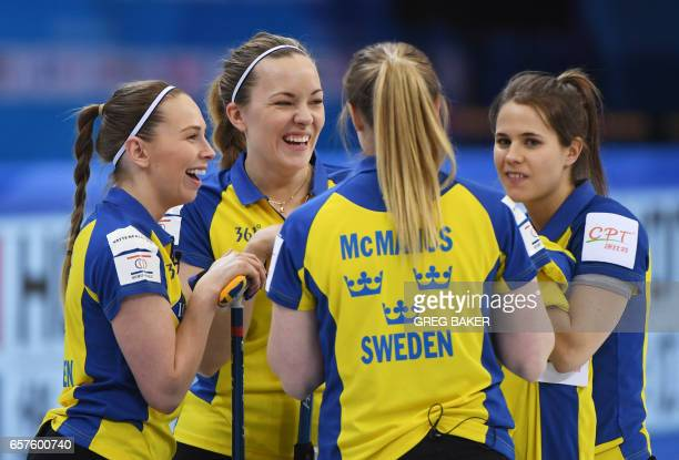 Sweden's Sofia Mabergs Agnes Knochenhauer Sara McManus and Anna Hasselborg chat during their playoff against Scotland at the Women's Curling World...