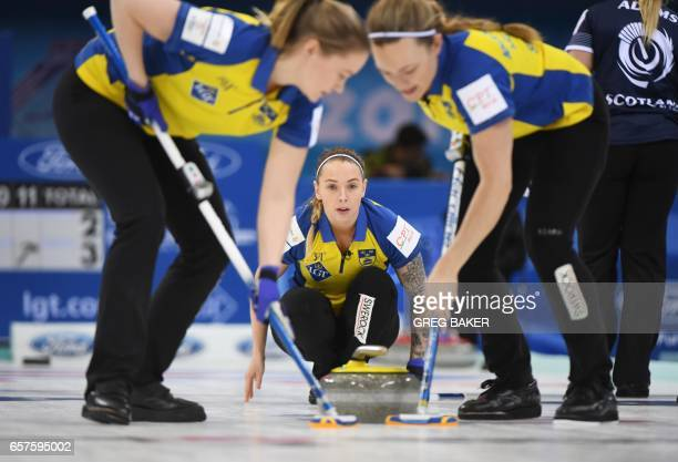 Sweden's Sofia Mabergs releases the stone during their playoff against Scotland at the Women's Curling World Championships in Beijing on March 25...
