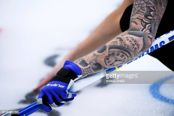 Sweden's Sofia Mabergs' tattoos are seen during the curling women's round robin session between Switzerland and Sweden during the Pyeongchang 2018...