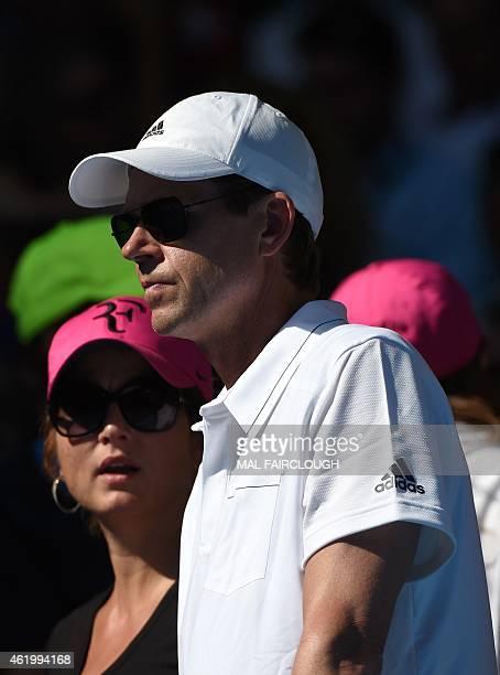 Sweden's Stefan Edberg coach to Switzerland's Roger Federer and Mirka Federer Federer's wife look on during his men's singles match against Italy's...