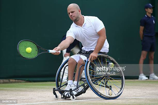 Sweden's Stefan Olsson returns against Britain's Gordon Reid during the men's wheelchair singles final match on the last day of the 2016 Wimbledon...