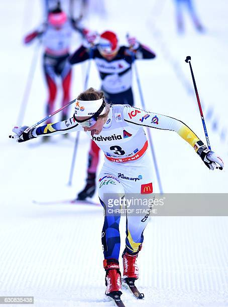 """Sweden's Stina Nilsson reacts as she passes the finish line of the ladies 5 kilometer skiathlon competition of the """"Tour de Ski"""" Cross Country World..."""