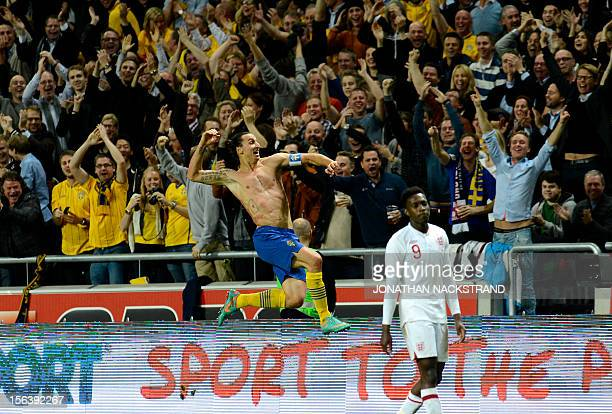 Sweden's striker and team captain Zlatan Ibrahimovic celebrates after scoring his 4th goal during the FIFA World Cup 2014 friendly match England vs...