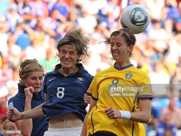 Sweden's striker Lotta Schelin and France's defender Sonia Bompastor vie for the ball during the Sweden vs France FIFA women's football World Cup...