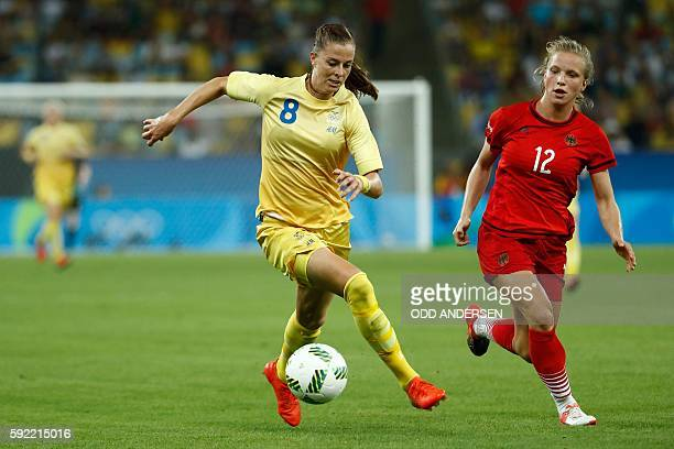Sweden's striker Lotta Schelin and Germany's defender Tabea Kemme vie for the ball during the Rio 2016 Olympic Games women's football Gold medal...