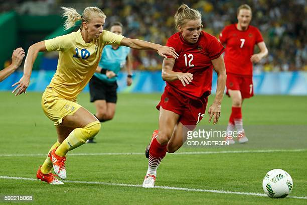 Sweden's striker Sofia Jakobsson and Germany's defender Tabea Kemme vie for the ball during the Rio 2016 Olympic Games women's football Gold medal...