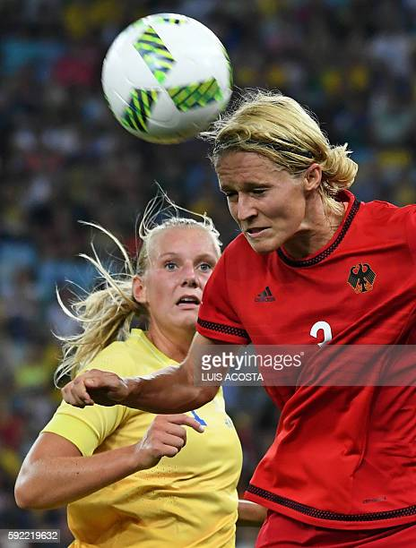 Sweden's striker Stina Blackstenius and Germany's defender and captain Saskia Bartusiak vie for the ball during the Rio 2016 Olympic Games women's...