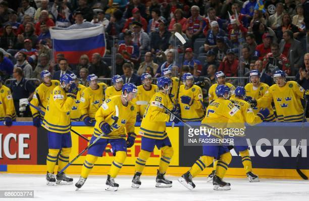Sweden's team celebrates a goal against Finland during the IIHF Men's World Championship Ice Hockey semi-final match between Sweden and Finland in...
