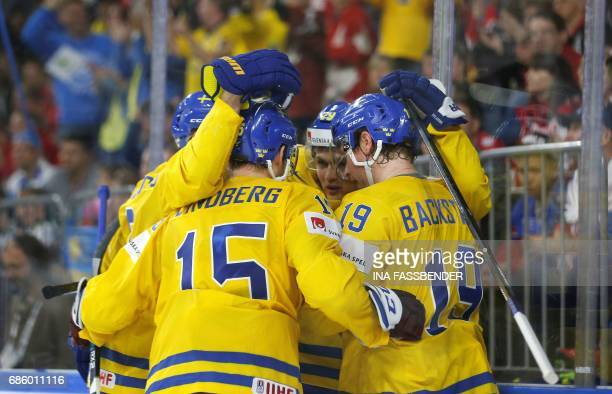 Sweden's team celebrates a goal during the IIHF Men's World Championship Ice Hockey semi-final match between Sweden and Finland in Cologne, western...
