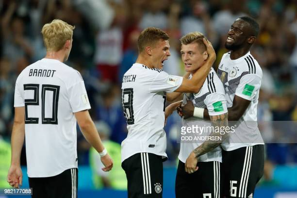 Sweden's team players celebrate after winning at the end of the Russia 2018 World Cup Group F football match between Germany and Sweden at the Fisht...