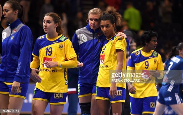 Sweden´s teamplayers react after they lost the IHF Womens World Championship handball halffinal match Sweden vs France on December 15 2017 in Hamburg...