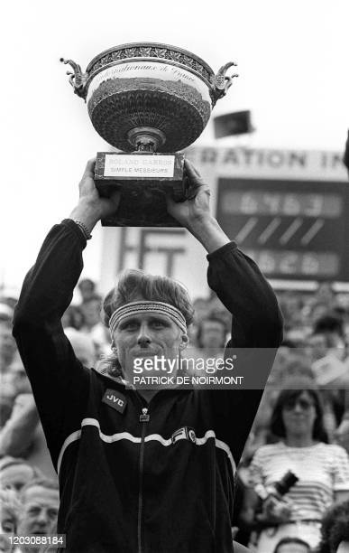 Sweden's tennis player Bjorn Borg holds up the Winner's Trophy here 7 june 1981 at Roland Garros Stadium after defeating Czech Ivan Lendl in the...