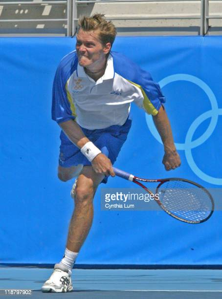 Sweden's Thomas Enqvist falls to Spain's Carlos Moya 6-7, 7-6, 7-9 in the first round match at the 2004 Olympic Games.