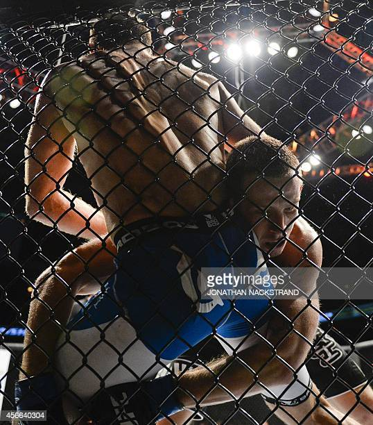 Sweden's Tor Troeng and Poland's Krzysztof Jotko fight in the ring during the Ultimate Fighting Championship Fight Night at the Globe Arena in...
