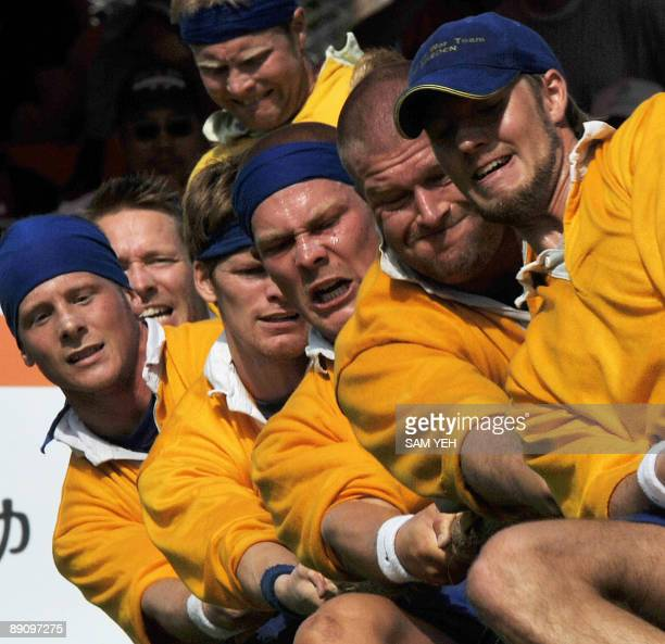 Sweden's tugofwar team duel with Great Britain during the men's 640kilogram event at the World Games in Kaohsiung on July 19 2009 The World Games...