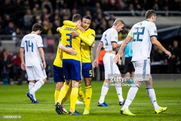 Sweden's Victor Nilsson Lindelof is embraced by teammate Martin Olsson after scoring the 10 goal during the UEFA Nations League B group two match...