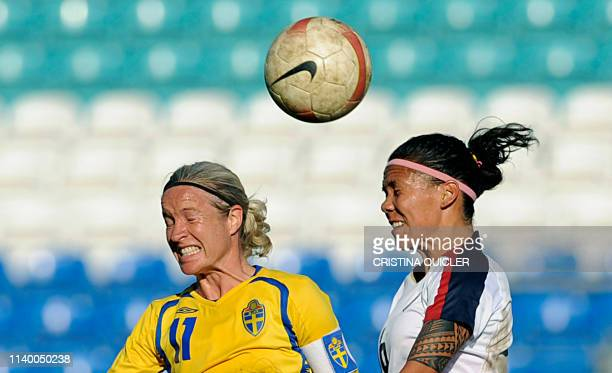 Sweden's Victoria Svensson vies with US Natasha Kai during the final of the Algarve cup women's soccer match in Faro at Algarve stadium, south-east...