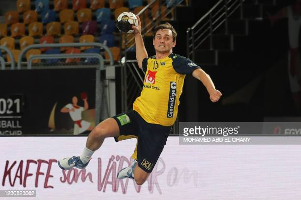 Sweden's wing Hampus Wanne jumps to shoot during the 2021 World Men's Handball Championship quarterfinal match between Sweden and Qatar at the Cairo...