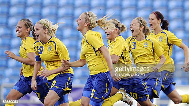 Sweden's women's soccer team celebrate after winning 43 in a penalty shootout against the US during the Final of the Algarve cup women's soccer match...
