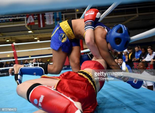 Sweden's Zina Djelassi fights with Ukraine's Natalia Martiukhina in the 'Women K1 60kg category' in the 'BOK' sports hall in Budapest on November 9...