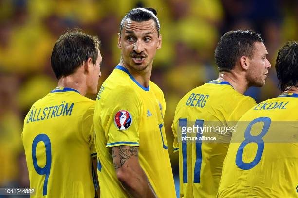 Sweden's Zlatan Ibrahimovic arranges the defense prior to a free kick next to Kim Kallstrom Marcus Berg and Albin Ekdal during the UEFA Euro 2016...