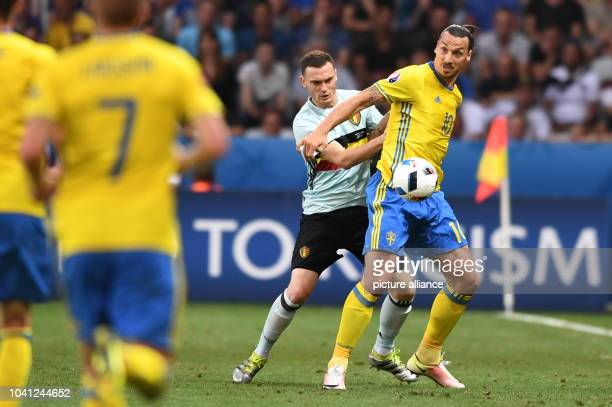 Sweden's Zlatan Ibrahimovic challenges for the ball with Belgium's Thomas Vermaelen during the UEFA Euro 2016 Group E soccer match between Sweden vs...