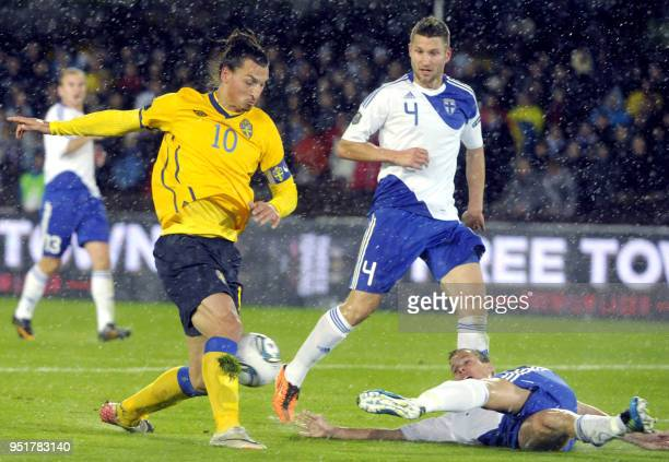 Sweden's Zlatan Ibrahimovic controlls the ball against Finland's Joona Toivio and Niklas Moisander during the UEFA Euro 2012 Group E qualifying...