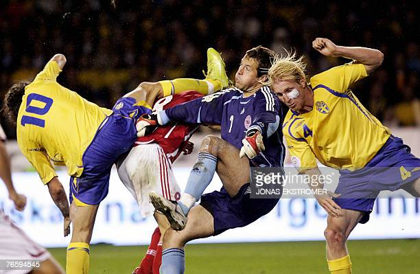 Sweden's Zlatan Ibrahimovic Denmark's Jesper Gronkjar Danish goalkeeper Thomas Sorensen and Sweden's Petter Hansson fight for the ball in their Euro...
