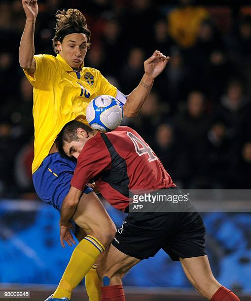 Sweden's Zlatan Ibrahimovic fights for the ball with Albania's Armend Dallku during the World Cup Group 1 qualifying football match at Rasunda...