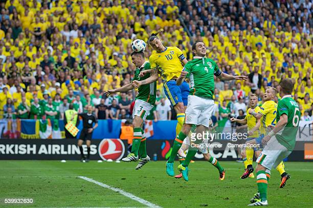 Sweden's Zlatan Ibrahimovic gets a header on goal under pressure from Republic of Ireland's Ciaran Clark during the UEFA Euro 2016 Group E match...