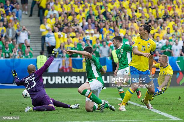 Sweden's Zlatan Ibrahimovic misses the target with his shot under pressure from Republic of Ireland's Ciaran Clark and Darren Randolph during the...