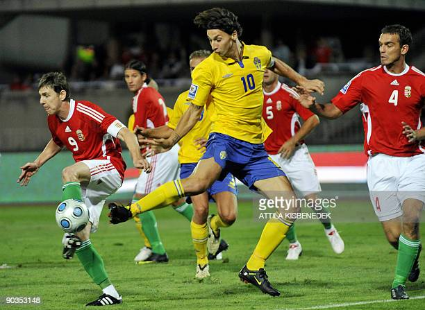Sweden's Zlatan Ibrahimovic vies for the ball with Hungary's Roland Juhasz and Zoltan Gera during their World Cup 2010 Qualifying match in Budapest...