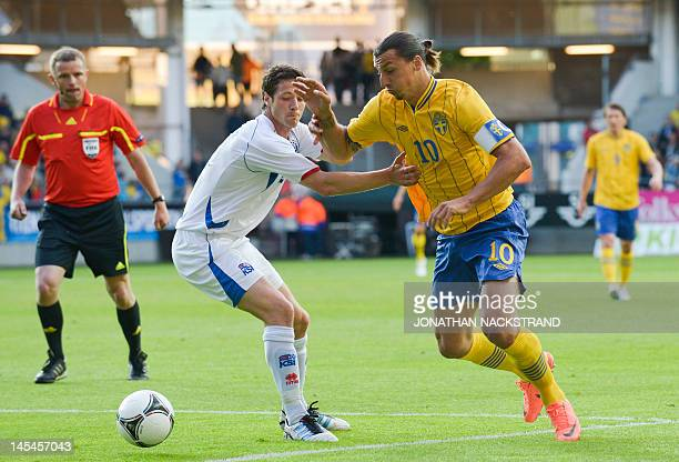 Sweden's Zlatan Ibrahimovic vies for the ball with Iceland's Hallgrimur Jonasson during their friendly football match at the Gamla Ullevi Stadium in...