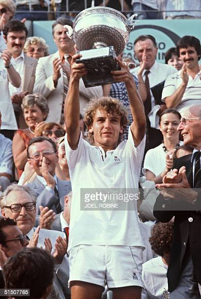 Swede's mats Wilander holds his tropy after winning the French Tennis Open at the Roland Garros stadium in Paris 06 June 1982