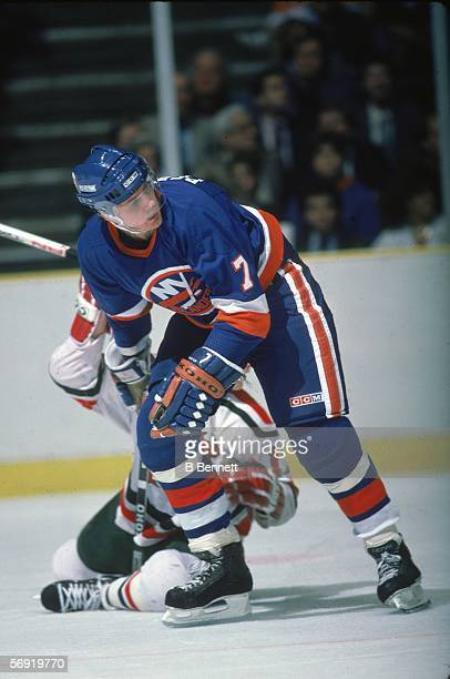Swediah hockey player Stefan Persson of the New York Islanders leaves an opponent on the ice during a game against the New Jersey Devils East...