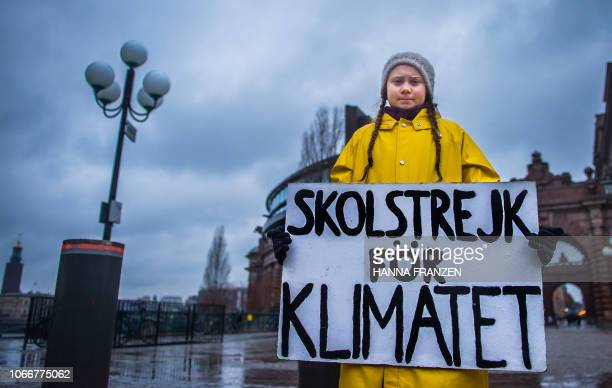 Swedish 15yearold girl Greta Thunberg holds a placard reading School strike for the climate during a protest against climate change outside the...