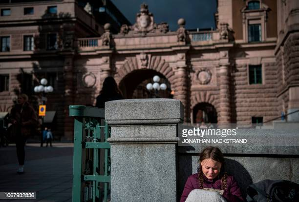 Swedish 15yearsold Greta Thunberg is pictured in front of the Swedish Parliament where she goes on school strike on September 28 2018 in Stockholm...