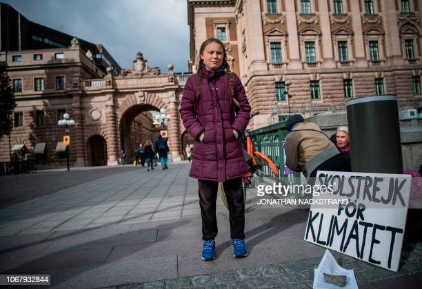 Swedish 15yearsold Greta Thunberg stands in front of the Swedish Parliament where she goes on school strike on September 28 2018 in Stockholm Greta...